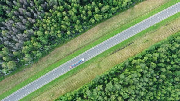 Thumbnail for Aerial Top View on Country Road in Forest