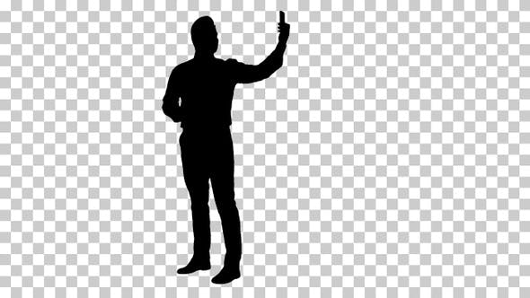 Thumbnail for Silhouette Happy young handsome businessman recording vlog