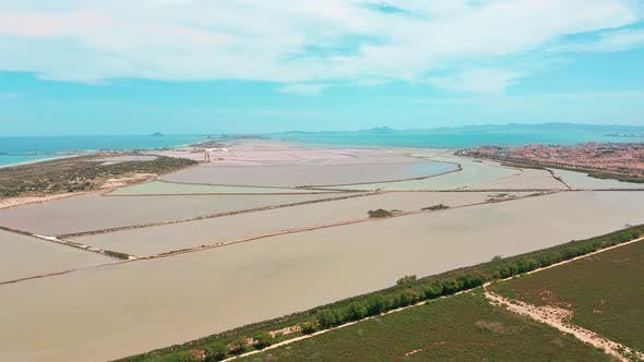 Multicolored Salt Lakes with Coastal Salt Marshes, Aerial View, Video Shooting with Drone. Pink Salt