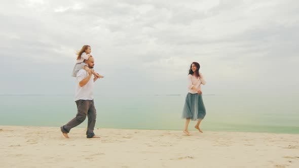 Thumbnail for Happy Family of Three People Running on the Beach. Fun Games with Children