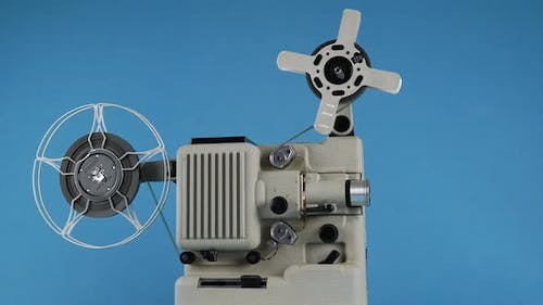 Rotating Vintage Movie Projector On A Blue Background