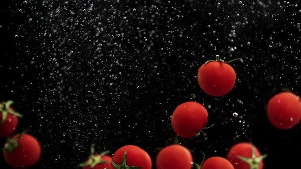 Thumbnail for Ripe Cherry Tomato Vegetables Splash Water with Air Bubbles Black Background in