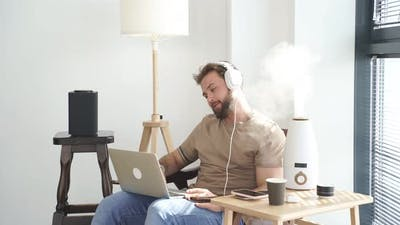 Caucasian Young Man Use Computer Laptop at Home in Relax Leisure Indoor Activity