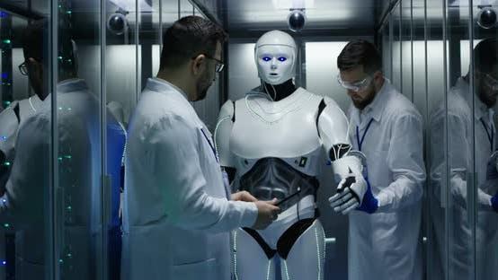 Engineers Testing on Robot Controls
