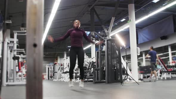 Sports Training  Black Woman Jumping on a Spot in the Gym