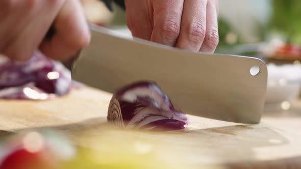 Thumbnail for Slicing Red Onion with Knife on Wooden Cutting Board