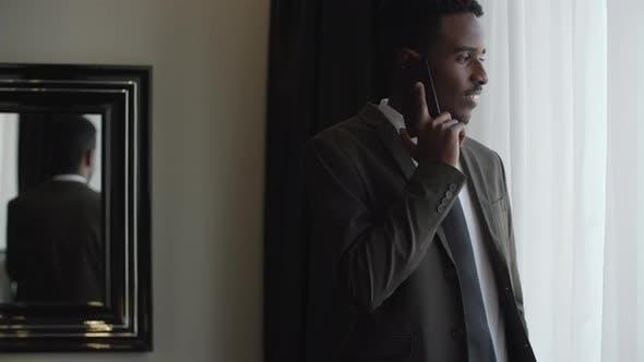 Thumbnail for Entrepreneur Speaking on Phone in Hotel Room