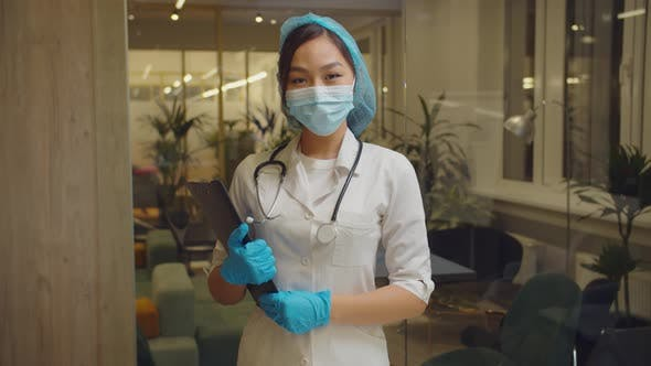 Positive Asian Female Doctor Smiling at Hospital
