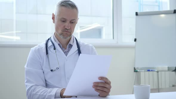 Thumbnail for Sad Doctor Reading Medical Report of patient