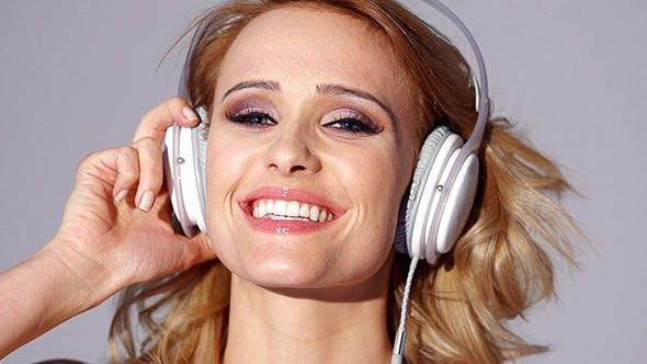 Thumbnail for Adorable Blond Girl Listening to Music on Headphones