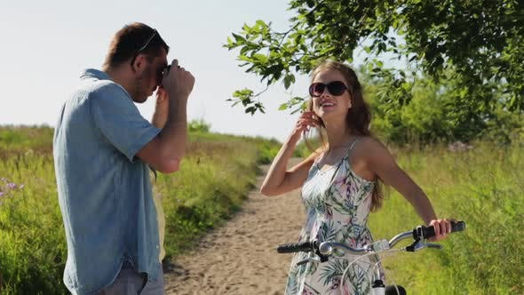 Thumbnail for Couple with Bicycle Photographing By Smartphone