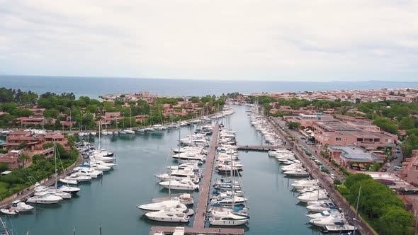 Thumbnail for Aerial View on White Sailing Yachts at Portorosa, Furnari, Italy. Mediterranean Sea, Mountains and