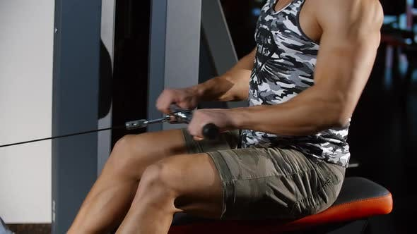 Thumbnail for Muscular Man Training Strong Hands and Back Exercising on Rowing Sport Machine