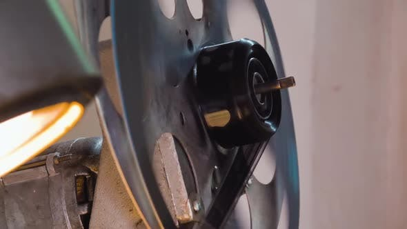 Large Spool with Film Reel Rotates By Old Cinema Equipment