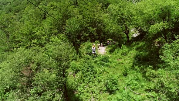 Aerial view of person zip-lining in Soca valley, Slovenia.