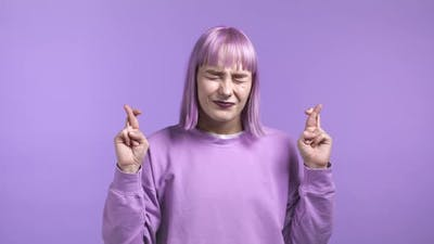 Pretty Trendy Woman Praying Over Violet Background