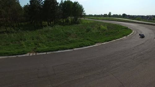 Motorcyclist Riding on Racing Track. Aerial View Moto Racing on Race Track