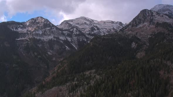 Thumbnail for Aerial shot moving slowly away from snow capped mountain peaks