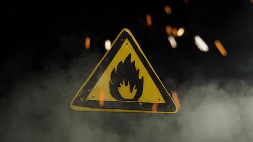 Flammable Materials Sign Over a Smoky Background