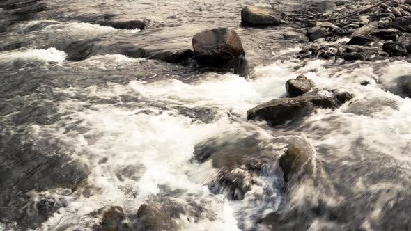 Powerful Flow of Water Over Stones