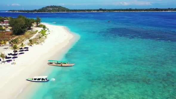 Thumbnail for Luxury aerial clean view of a white sandy paradise beach and turquoise sea background in hi res 4K