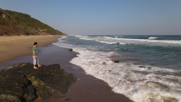 Watching Ocean Waves on Rock