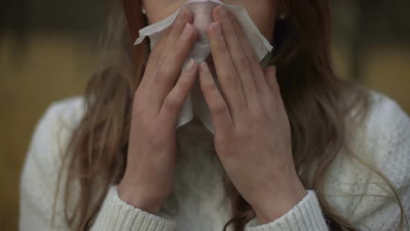 Cover Image for Girl Suffering from Runny Nose and Teardrop Discharge, Symptom of Seasonal Virus