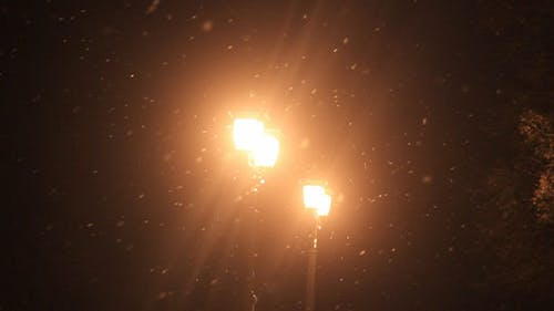 Old Street Light and Falling Snow
