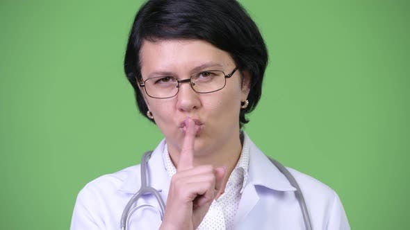 Thumbnail for Beautiful Woman Doctor with Finger on Lips