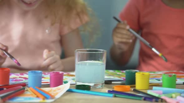 Thumbnail for Two Multiracial Children Painting with Watercolors at Workshop, Creativity