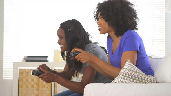 Thumbnail for Two African American friends playing video games together