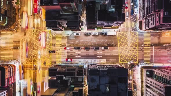 Thumbnail for Time-lapse of car traffic on road and people crossing street at night in Hong Kong downtown district