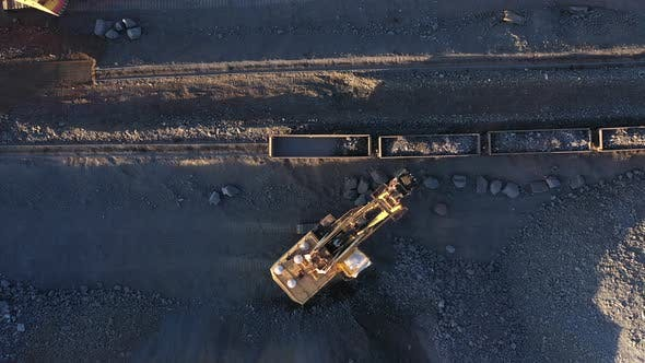 Thumbnail for Excavator Loads Ore Into Freight Cars