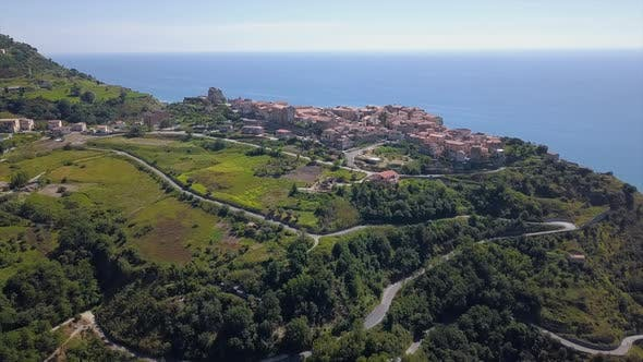 Thumbnail for Aerial View Drone Flight Over Medieval City on Hill Top Overlooking Sea Coast Village and Mountains