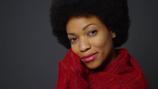 Thumbnail for African woman with afro wearing red shawl