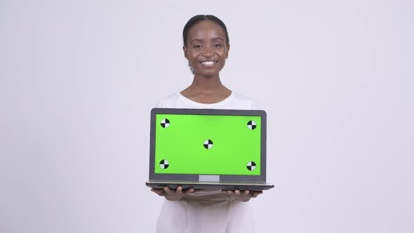 Thumbnail for Happy Young Beautiful African Woman Showing Laptop