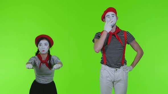 Mimes Actors On Green Background