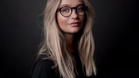 Thumbnail for Blond Woman In Glasses Posing