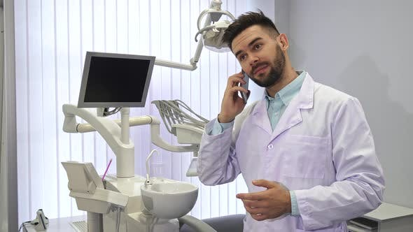 Thumbnail for Dentist Dials Somebody on the Phone at the Office