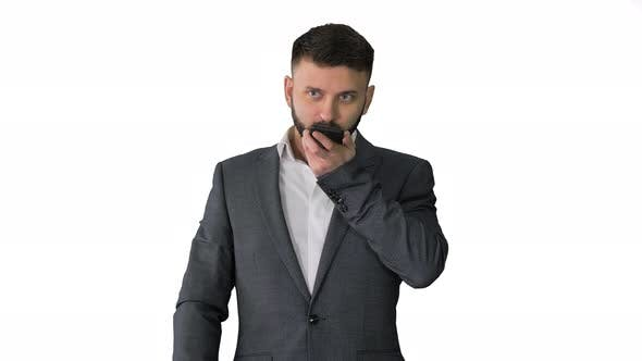 Thumbnail for Turk Businessman Using Smartphone's Digital Voice Assistant on White Background.