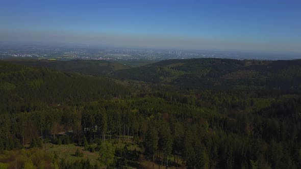Thumbnail for AERIAL: Flight Over German Forest with City in the Back, Frankfurt, Germany, Sunshine