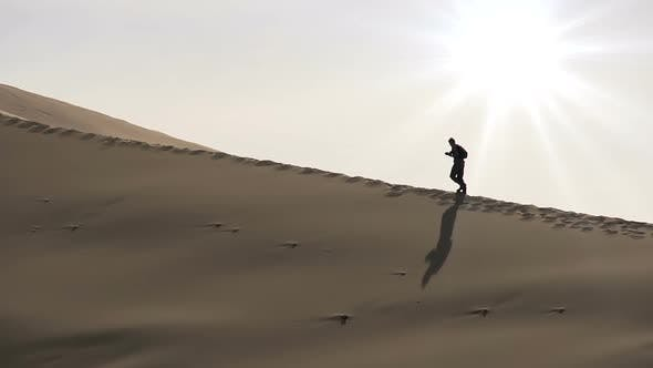 The Researcher Goes On Dunes