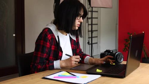Creative Female Photographer Using Graphic Drawing Tablet and Stylus Pen