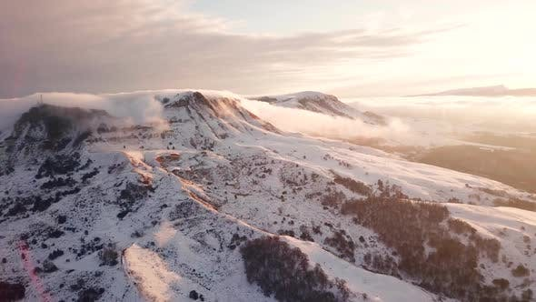 Thumbnail for Great Aerial Landscape Mountain View of the Snowy Massive Rock in Sunlight.