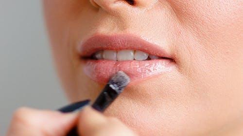 Makeup Artist Doing Lip Corrections on Woman