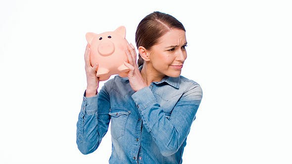 Thumbnail for Girl With Her Piggy Bank Posing Isolated on White