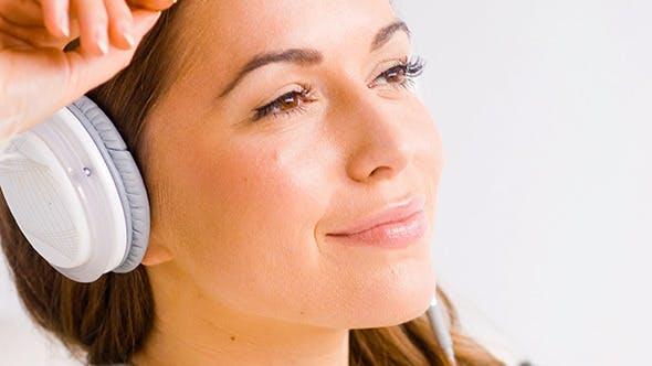 Thumbnail for Happy Girl Listening to Music in White Headphones