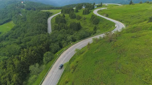 Thumbnail for Mountain Landscape with A Curvy Road in Bulgaria. Drone Follows Car
