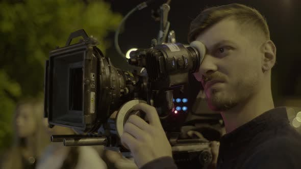 Thumbnail for Cameraman with a Camera During Filming. Filmmaking. Shooting.