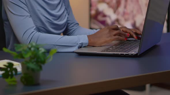 Thumbnail for Close Up of African Woman Typing on Laptop